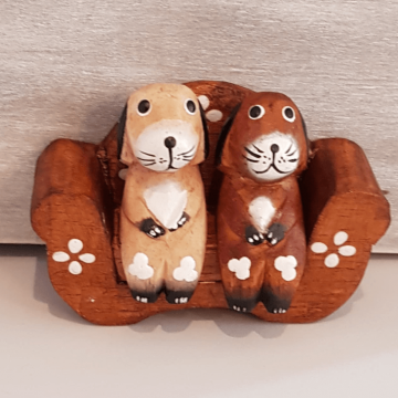 Hand Carved Wooden Dogs Sat On Sofa
